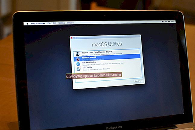 Como carregar um disco em um computador Apple iMac